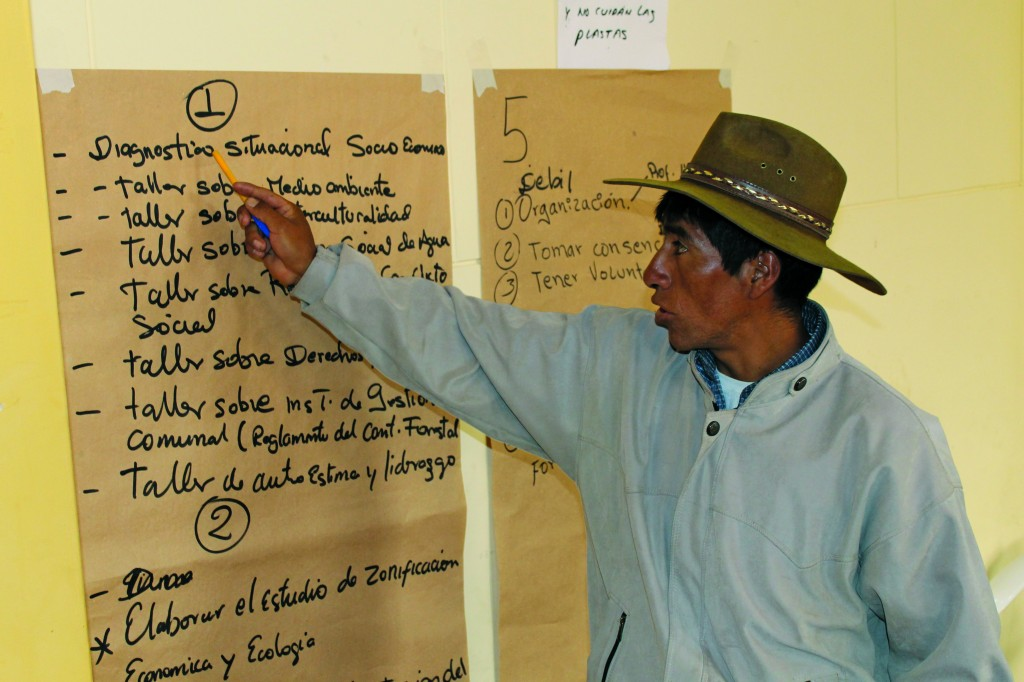 A community member analyses project components during a community consultation